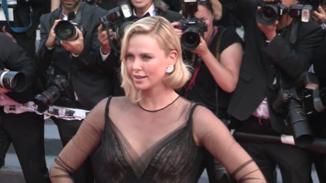 we spotted the stunning charlize theron on the red carpet for the 70th anniversary of the cannes film festival on may 23, 2017 in cannes, france. - シャーリーズ・セロン点の映像素材/bロール