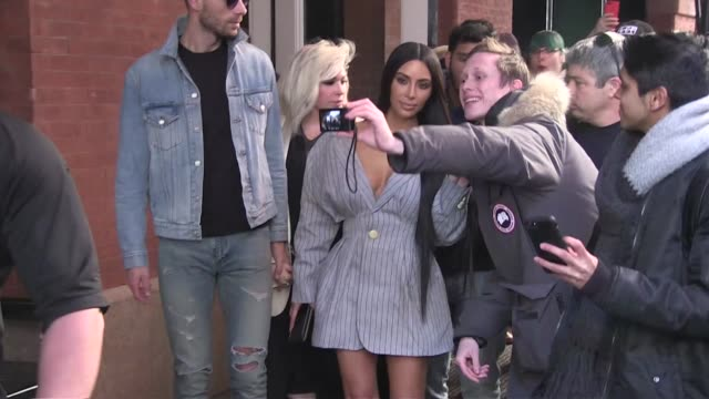 We spotted the tabloid fave Kim Kardashian swarmed by the press and her fans in New York City the star is in town for the Ready To Wear fall winter...