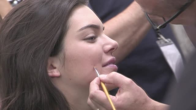 we spotted the young models gigi hadid and kendall jenner getting ready backstage for the elie saab spring summer 2016 fashion show in paris saturday... - gigi hadid stock videos & royalty-free footage