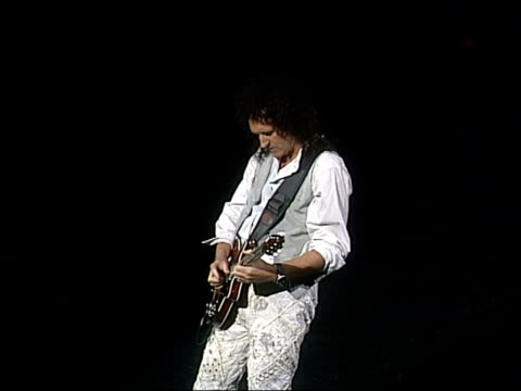 Second anniversary ITN ENGLAND London Cast performing Queen musical 'We Will Rock You' EXT i/c INT SEQUENCE Queen guitarist Brian May rehearsing for...