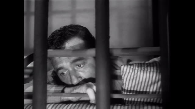 1952 A weak imprisoned man is dragged to and from his cell