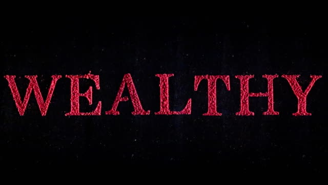 Wealthy in red exploding text in slow motion.