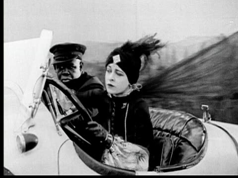 1925 b/w ms wealthy woman (madeline hurlock) driving convertible with man riding in passenger seat / los angeles county, california, usa - passenger seat stock videos & royalty-free footage