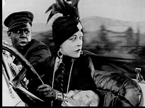 1925 B/W MONTAGE MS Wealthy woman (Madeline Hurlock) driving convertible with man riding in passenger seat / Los Angeles County, California, USA