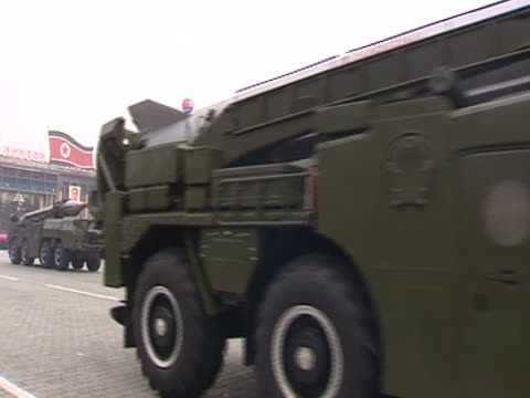 Weapons are mobilised on trucks at a massive military parade in the North Korean capital Pyongyang before Kim JongIl and Kim Jong un