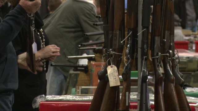 weapons being sold at showmasters gun shows on march 23, 2013 in richmond, virginia - exhibition stock videos & royalty-free footage