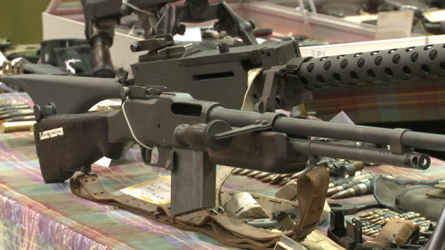 weapons being sold at showmasters gun shows on march 23 2013 in richmond virginia - rifle stock videos & royalty-free footage