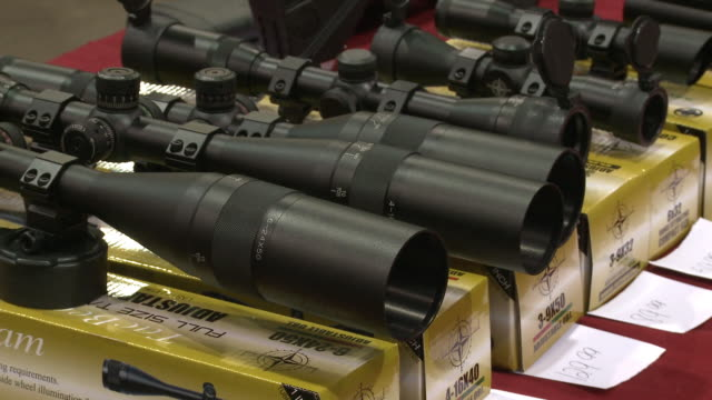 vídeos de stock, filmes e b-roll de weapons being sold at showmasters gun shows on march 23 2013 in richmond virginia - rifle