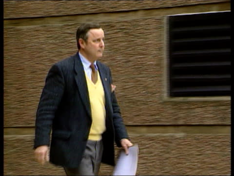 IRA weapons inspected ITN General John de Chastelain along from building to microphone