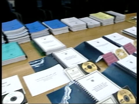 weapons inspectors report to the un; lib iraq: cms books and cd-rom's containing iraq's declaration of its weapons programmes declaration laid out on... - cd rom stock videos & royalty-free footage