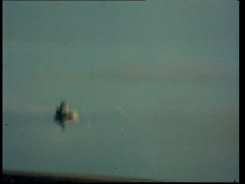 stockvideo's en b-roll-footage met mod weapons mod weapons pool ls ship in san carlos bay pull out missiles ms rapiers g/a missile explodes in air gv ship in bay pan explosion in water... - falklandeilanden
