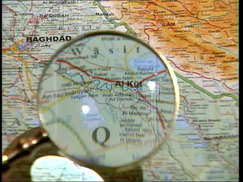 blair changes emphasis/ powell statement itn england london gir magnifying glass held over map of iraq magnifying glass held over screen showing... - weapons of mass destruction stock videos & royalty-free footage
