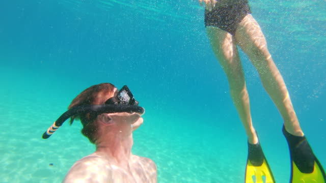ms wearable camera point of view couple snorkeling underwater in sunny blue ocean,peljesac,croatia - swimming goggles stock videos & royalty-free footage