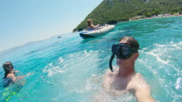 MS Wearable camera point of view man jumping into sunny blue ocean,Peljesac,Croatia