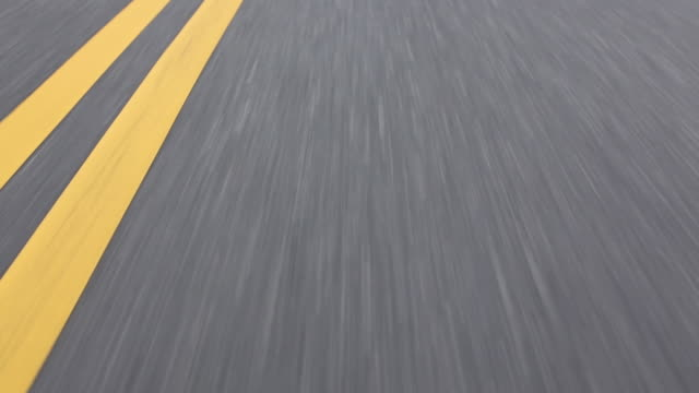 Wearable camera shot showing tarmac and road markings, Long Island, USA.