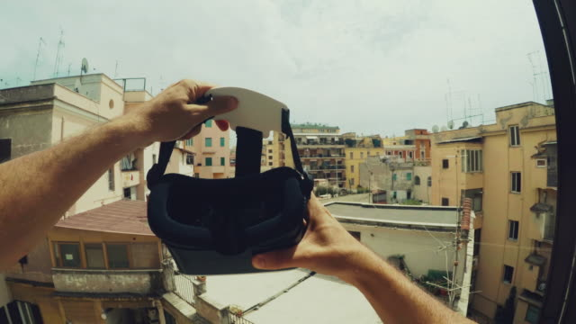 pov wearing a vr augmented reality headset - realtà aumentata video stock e b–roll