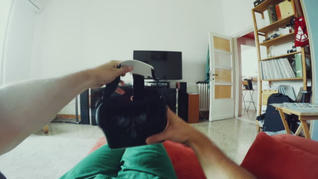pov wearing a vr augmented reality headset - home video camera stock videos and b-roll footage