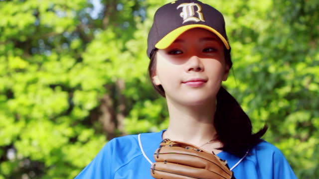 cu ds slo mo wearing baseball cap with baseball hand gloves and woman smiling / seoul, south korea - baseball cap stock videos & royalty-free footage