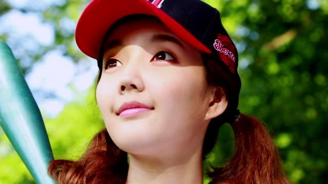 cu pan slo mo wearing baseball cap woman smiling / seoul, south korea - baseball cap stock videos & royalty-free footage