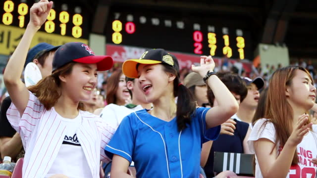 MS SLO MO Wearing baseball uniform women cheering at stadium / Seoul, South Korea