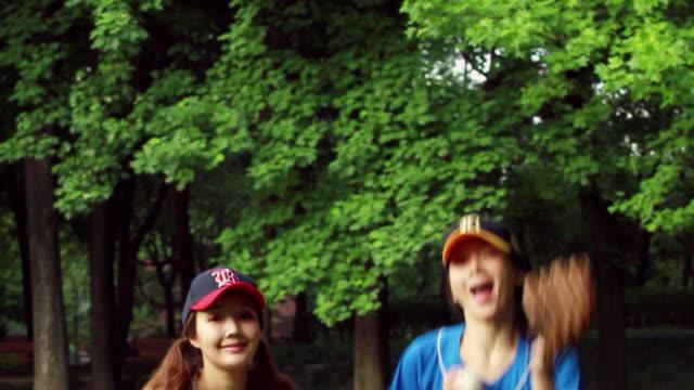 MS SLO MO Wearing baseball uniform women jumping / Seoul, South Korea