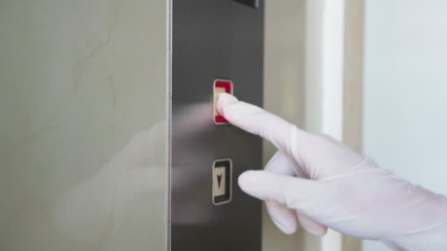 wearing glove to pressing on elevator button for infection prevention - hotel stock videos & royalty-free footage