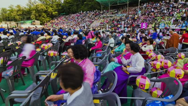 ms t/l ds wearing hanbok buddhist prayer gathering for buddha's birthday event / seoul, south korea - buddha's birthday stock videos and b-roll footage
