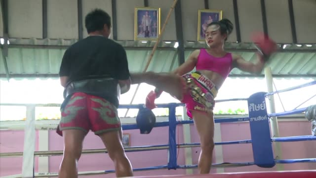 wearing red lipstick and a pink sports bra nong rose trades blows with her twin brother in a thai boxing gym preparing for a foreign debut that will... - pink lipstick stock videos and b-roll footage