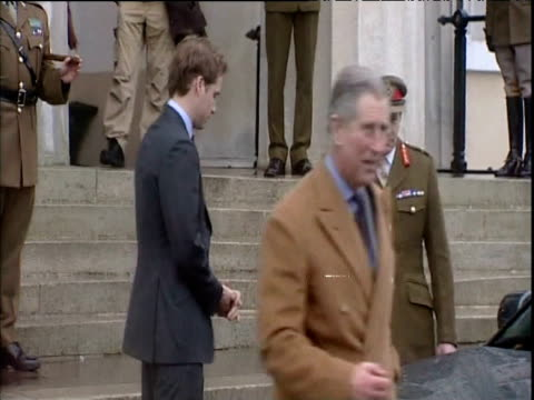 wearing red name badge in preparation for military training prince william waves goodbye to prince charles as he is driven away from royal military... - badge stock videos & royalty-free footage