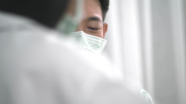 wearing surgical mask to protect - asian man coughing stock videos & royalty-free footage