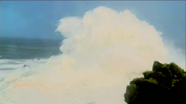 'weather bomb' hits north west of uk scotland outer hebrides st kilda ext large waves crashing on rocks rough seas beyond houses in strong wind and... - hebrides stock videos & royalty-free footage