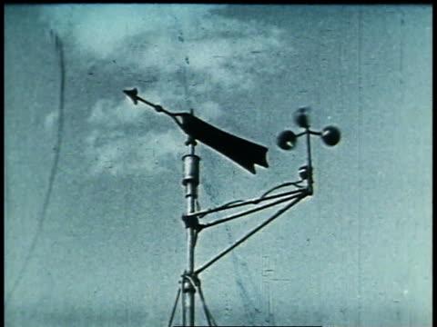 1938 MONTAGE weather bureau men taking measurements / United States