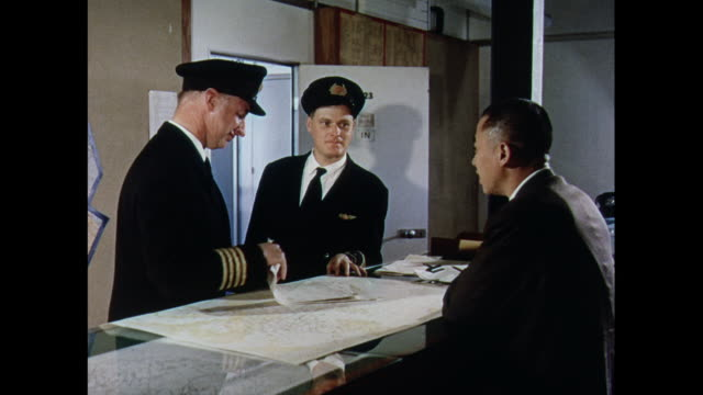 MONTAGE Weather forecaster meets with pilots and an air display of current aircraft in Farnborough / United Kingdom