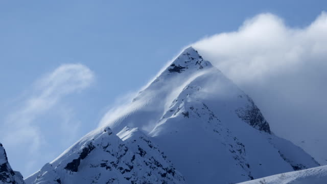 weather rolls over alaskan peak, timelapse - cold temperature stock videos & royalty-free footage
