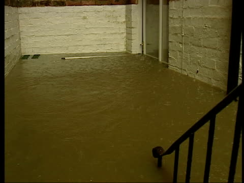 Weather storms and flooding across Britain YTV = NO RESALE Harrogate Flooded basement of house PAN MS Door with water at halfway point PULL OUT...