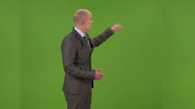 hd: weathercaster on a chroma key background - forecasting stock videos & royalty-free footage