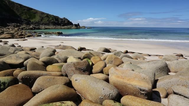 weathered granite boulders on the beach at porthmeor cove, on cornwall's north coast, uk. - boulder stock videos & royalty-free footage
