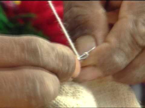 weathered male fingers knitting hand-made small knit garment section, quickly looping wool yarn w/ small stitches, hand-woven textiles. - knitting needle stock videos & royalty-free footage