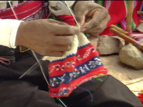 peru south america ms weathered male hands knitting small garment changing needles patience tedious artistic art handmade handwoven textiles - peruvian ethnicity stock videos & royalty-free footage