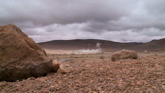 weathered rocks and geysers in atacama, bolivia - weathered stock videos & royalty-free footage