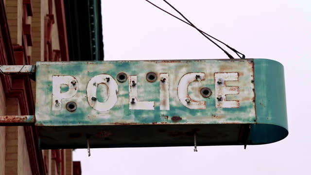weathered sign at a police station - bribing stock videos & royalty-free footage