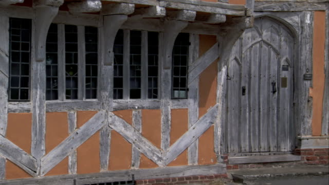 weathered timber covers medieval house in lavenham, england. available in hd. - lavenham stock-videos und b-roll-filmmaterial