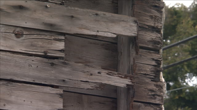 weathered wood planks cover the side of a building. - weathered stock videos & royalty-free footage