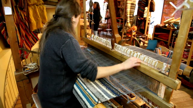 weaver at work, belluno, italy - ラグ点の映像素材/bロール