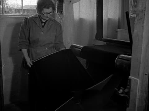 a weaver looks at the finished velvet which will be used for the coronation robe for elizabeth the second 1953 - 1953 stock videos and b-roll footage