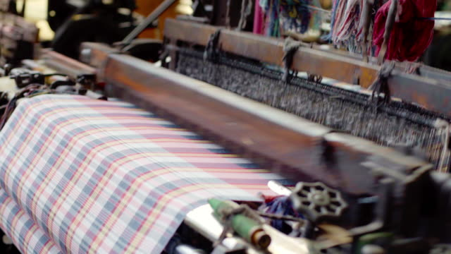 weaver machine retro style threads on a loom weaving textile fabric in factory. - loom stock videos & royalty-free footage