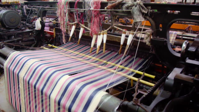 weaver machine retro style threads on a loom weaving textile fabric in factory. - needle plant part stock videos & royalty-free footage
