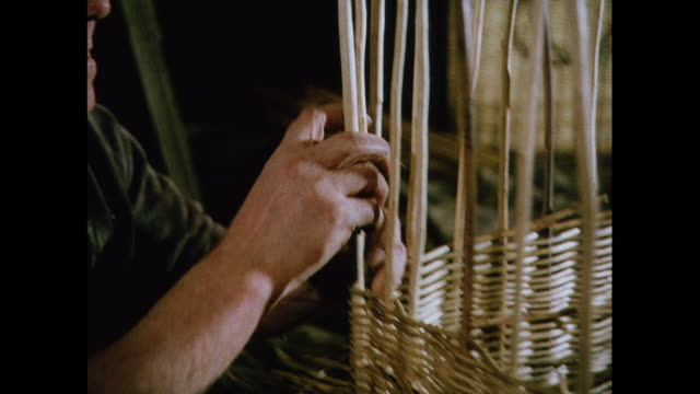 montage weaving of objects by the blind in united kingdom - intrecciare cestini video stock e b–roll