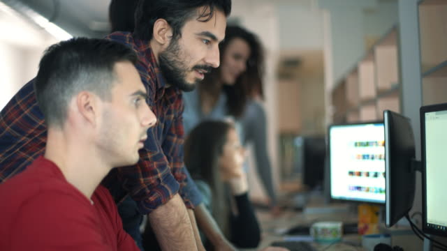 web designers at work. - colleague stock videos & royalty-free footage