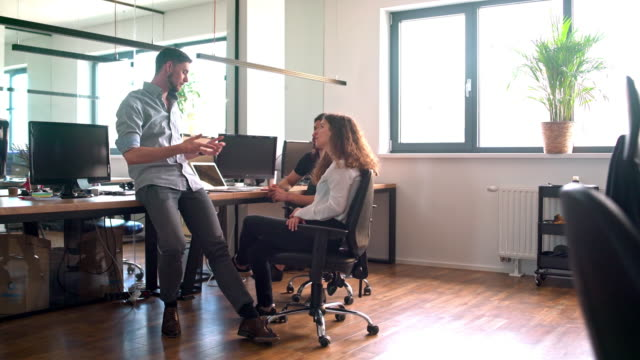 web designers discussing in the office - web designer stock videos & royalty-free footage